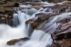 A slow shutter speed can be used to create dreamlike water effects