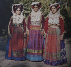 Balkan ladies in their national dress, showcasing how the Autochrome process enhanced the reds of their outfits - What is photography?