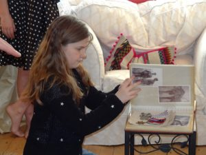 Lucy looking at Grandad's photos - What did you do in the war Grandad?