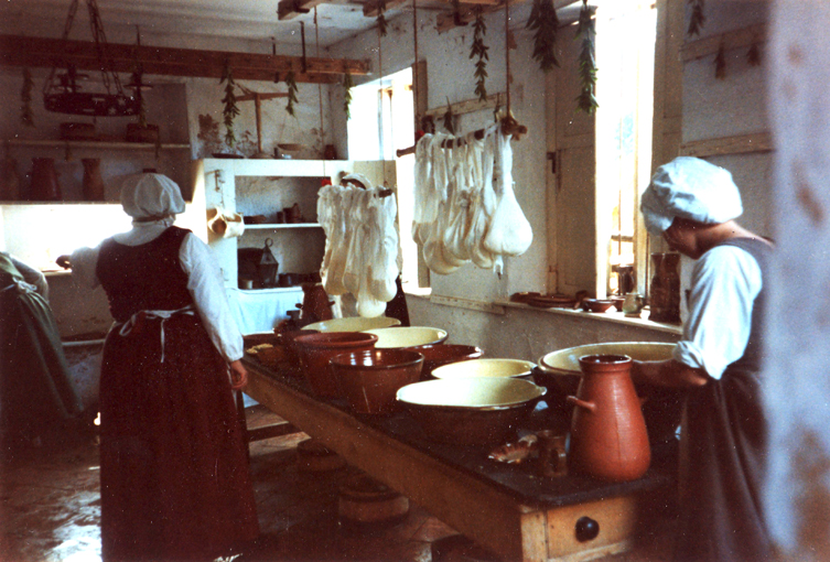 Cheese making in the dairy at Kentwell Hall